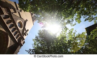 Church with sun and lens flare - video Footage of a church...