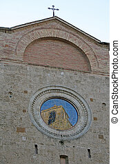 Church with the reflection in the window of an ancient medieval tower