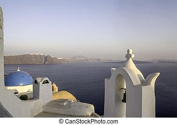 Churches on Santorini Cliffs with orange sky