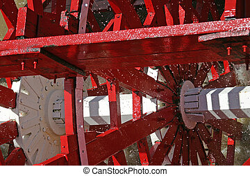 Churning Paddle Whee - A closeup of a paddle wheel, captured...