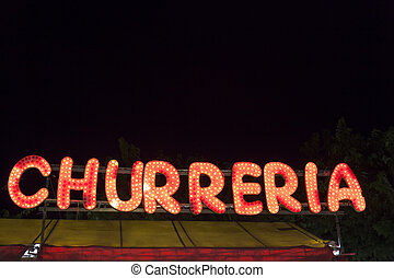 Churreria sign at night
