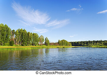 Chusovaya river in rising sun beams. Summer in Russia