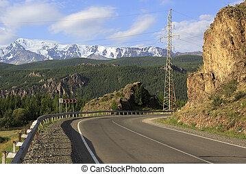 Chuysky Trakt and snow caps of North Chuya ridge.
