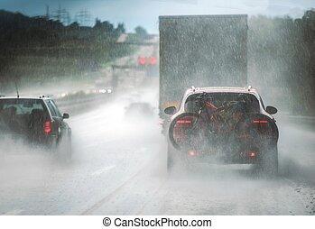ciężkie kupczenie, deszcz, szosa