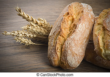 ciabatta bread with ears of corn on the wooed table