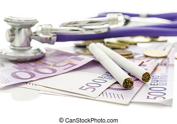 Ciarettes and stethoscope on Euro money