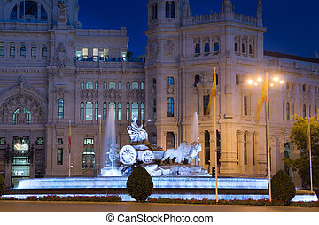 Cibeles Fountain at night with City Hall of Madrid in the...