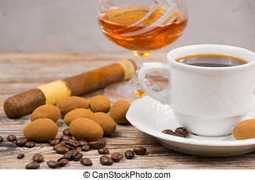 Cigar, brandy, cup coffee espresso with chocolate eggs