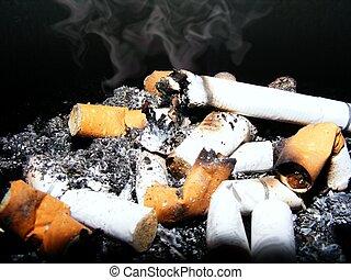stinky cigars on black background