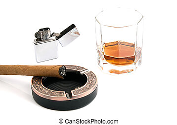 cigar in ashtray and whiskey