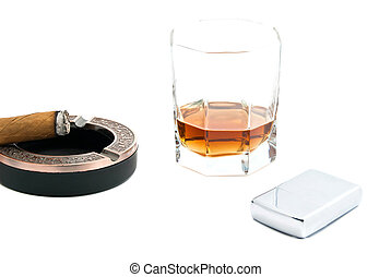 cigar in ashtray, lighter and cognac on white