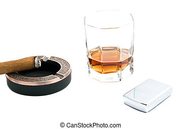 cigar in ashtray, metal lighter and cognac