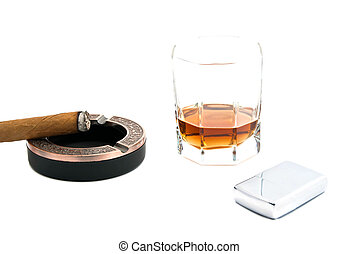 cigar in ashtray, metal lighter and whiskey