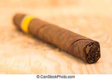Cigar on a wooden board