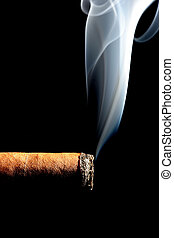 cigar smoke - cigar with smoke over black, limited depth of...
