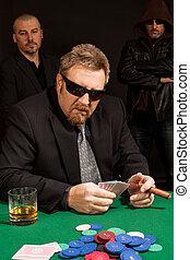 Cigar smoking whisky drinking poker player