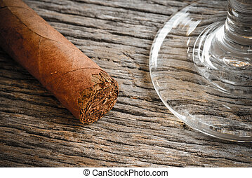 Cigar with Glass of Brandy or Whiskey on Wooden Background