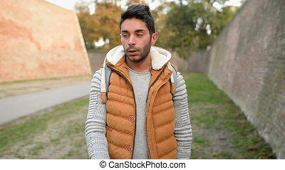 Cigarette addiction - Young handsome man enjoying a...
