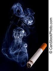 Smoking cigarette closeup in dark background with smoke