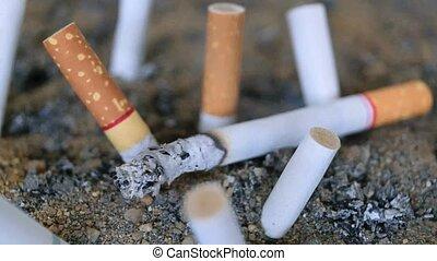 Cigarette burning in ashtray, Timelapse - Cigarette burning...