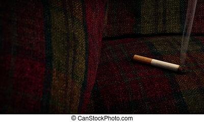 Cigarette Burning Sofa - Fire Hazard Concept - Cigarette...