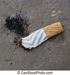 cigarette butt with ash showing shoe print