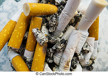 cigarette butts, chain-smoking - cigarette butts in an ...