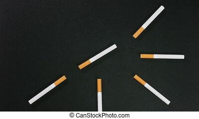 Cigarette clock on black surface