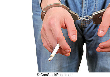 Cigarette in a Hand with Handcuffs