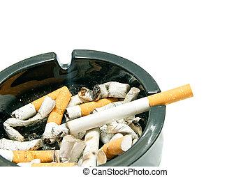 cigarette in black ashtray on white