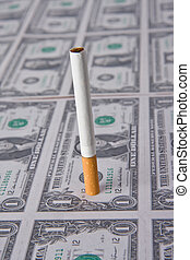 cigarette laying on money