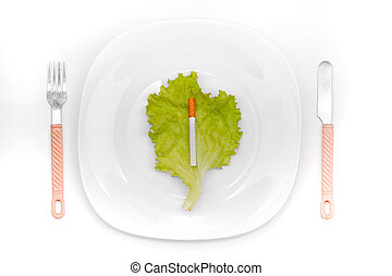 Cigarette On Dinner Plate - Cigarette on the lettuce leaf in...