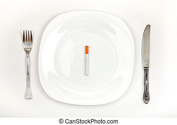 Cigarette On Dinner Plate - Concept of Cigarette on a Dinner...