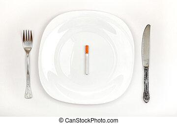 Cigarette On Dinner Plate - Concept of Cigarette on a Dinner...