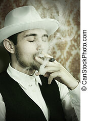 cigarette smoke - A young man in a hat with a cigar