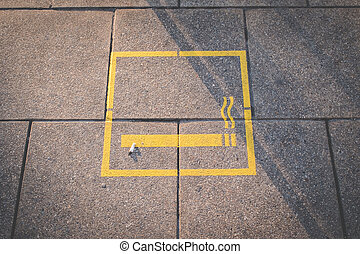cigarette , smoking area symbol on floor