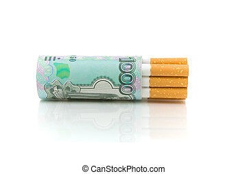 Cigarettes and money on a white background close-up