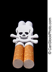 Cigarettes and scull on blue background Closeup