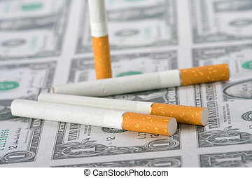 cigarettes laying on money
