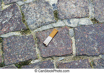 cigarettes on the ground .close-up, stop smoking concept