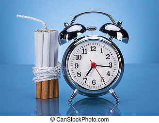 Cigarettes Tied With Rope And Alarm Clock Over Blue Background