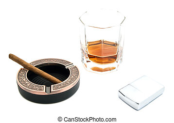 cigarillo, cognac and metal lighter