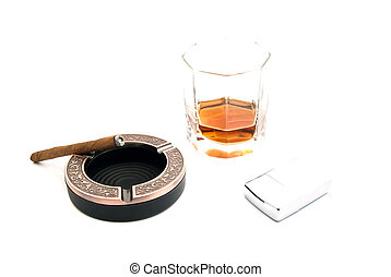 cigarillo in ashtray, cognac and lighter