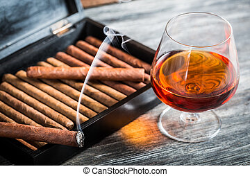 Cigars in humidor and cognac