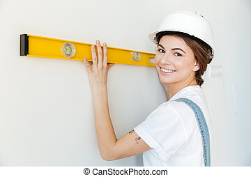 cima, retrato, de, um, mulher sorridente, construtor, em,...