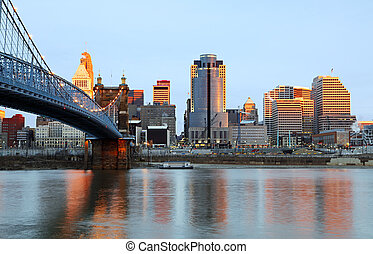 Downtown Cincinnati, Ohio and the John A. Roebling Suspension Bridge at sunrise.