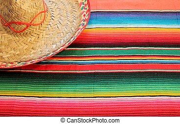poncho sombrero fiesta Mexico serape blanket rug background culture cinco de mayo Mexican rug with copy space