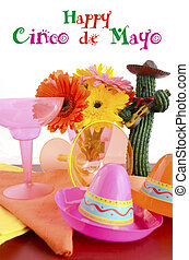 Happy Cinco de Mayo bright colorful party table place setting with bright gerbera daisy flowers on distressed red wood table.