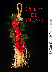Cinco de Mayo text on black background with red hot peppers