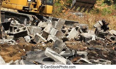 Cinderblocks and mini excavator. - Mini excavator clearing...